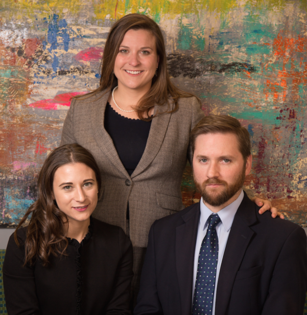 (from left to right): Leah Henderson, Jessica Burke, and Zachary Weight pose for a formal team photo
