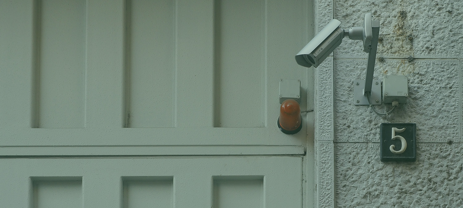 security camera pointed down at a doorway