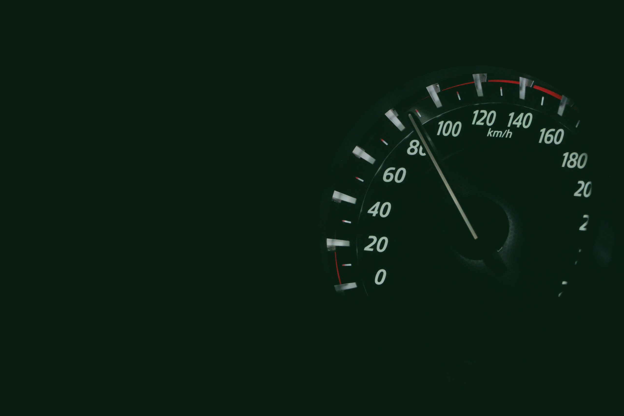 speedometer against a black background